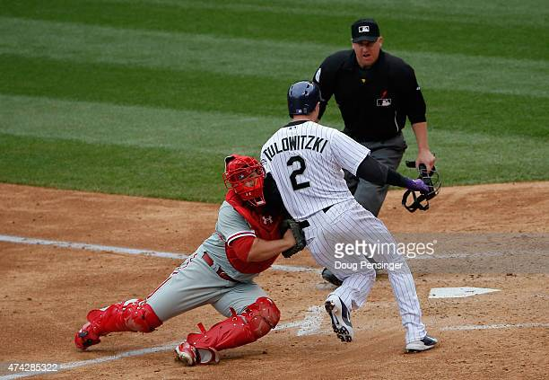 Troy Tulowitzki of the Colorado Rockies is tagged out at home plate by catcher Cameron Rupp of the Philadelphia Phillies as umpire Ryan Blakney...