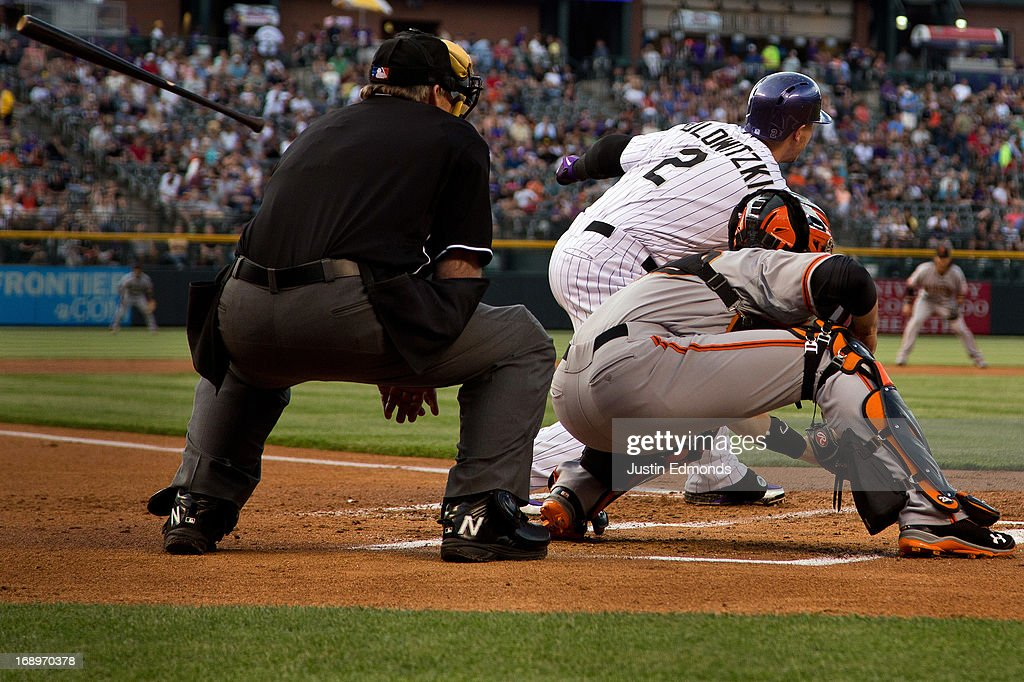 <a gi-track='captionPersonalityLinkClicked' href=/galleries/search?phrase=Troy+Tulowitzki&family=editorial&specificpeople=757353 ng-click='$event.stopPropagation()'>Troy Tulowitzki</a> #2 of the Colorado Rockies loses control of his bat during the first inning against the San Francisco Giants at Coors Field on May 17, 2013 in Denver, Colorado.