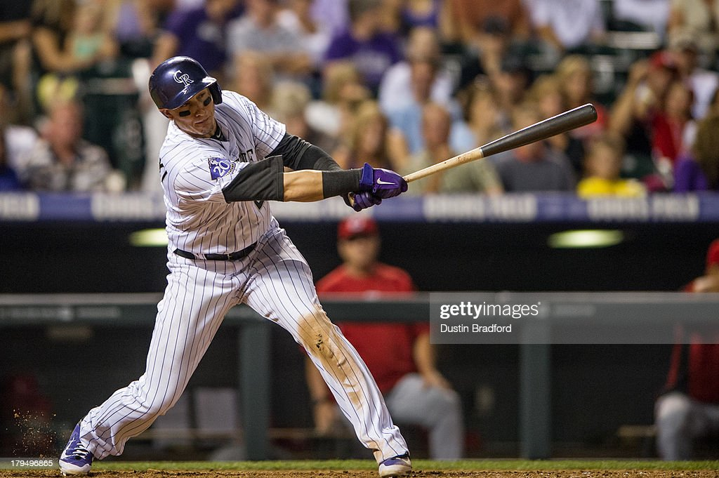 <a gi-track='captionPersonalityLinkClicked' href=/galleries/search?phrase=Troy+Tulowitzki&family=editorial&specificpeople=757353 ng-click='$event.stopPropagation()'>Troy Tulowitzki</a> #2 of the Colorado Rockies singles in the eighth inning of a game against the Cincinnati Reds at Coors Field on August 30, 2013 in Denver, Colorado. The Rockies beat the Reds 9-6.