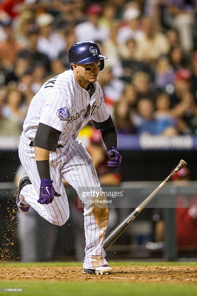 <a gi-track='captionPersonalityLinkClicked' href=/galleries/search?phrase=Troy+Tulowitzki&family=editorial&specificpeople=757353 ng-click='$event.stopPropagation()'>Troy Tulowitzki</a> #2 of the Colorado Rockies singles in the seventh inning of a game against the Cincinnati Reds at Coors Field on August 30, 2013 in Denver, Colorado. The Rockies beat the Reds 9-6.