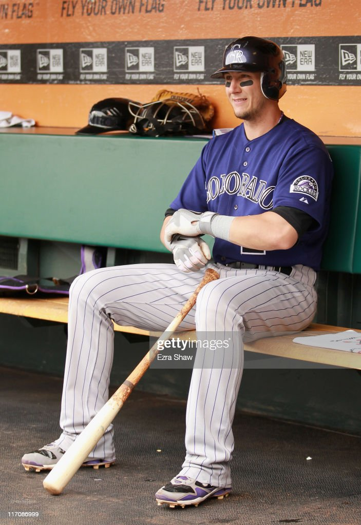Troy Tulowitzki #2 of the Colorado Rockies sits in the dugout before their game against the San Francisco Giants at AT&T Park on June 5, 2011 in San Francisco, California.