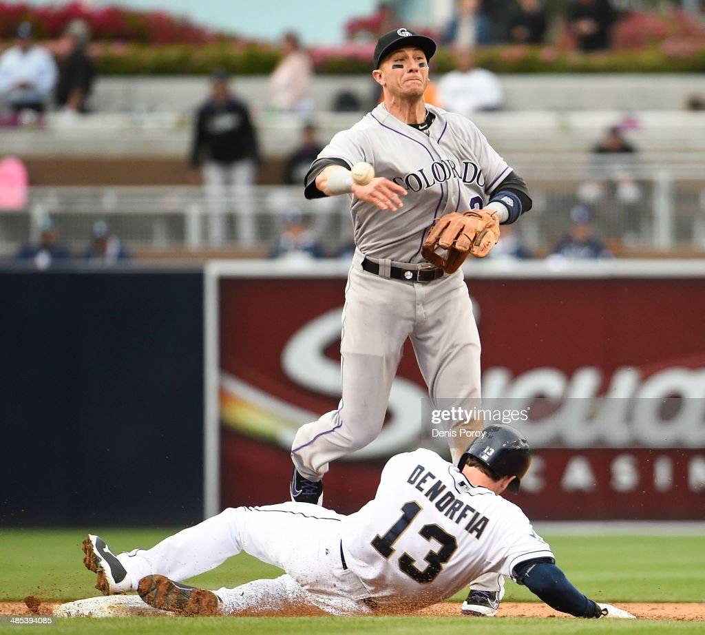 Troy Tulowitzki #2 of the Colorado Rockies throws over Chris Denorfia #13 of the San Diego Padres as he turns a double play to end the game in the ninth inning of a baseball game at Petco Park April 17, 2014 in San Diego, California. The Rockies won 3-1.