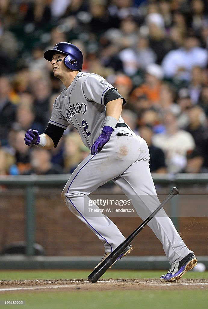 <a gi-track='captionPersonalityLinkClicked' href=/galleries/search?phrase=Troy+Tulowitzki&family=editorial&specificpeople=757353 ng-click='$event.stopPropagation()'>Troy Tulowitzki</a> #2 of the Colorado Rockies watches as his ball goes over the left field fence for a solo home run against the San Francisco Giants in the fifth inning at AT&T Park on April 9, 2013 in San Francisco, California.