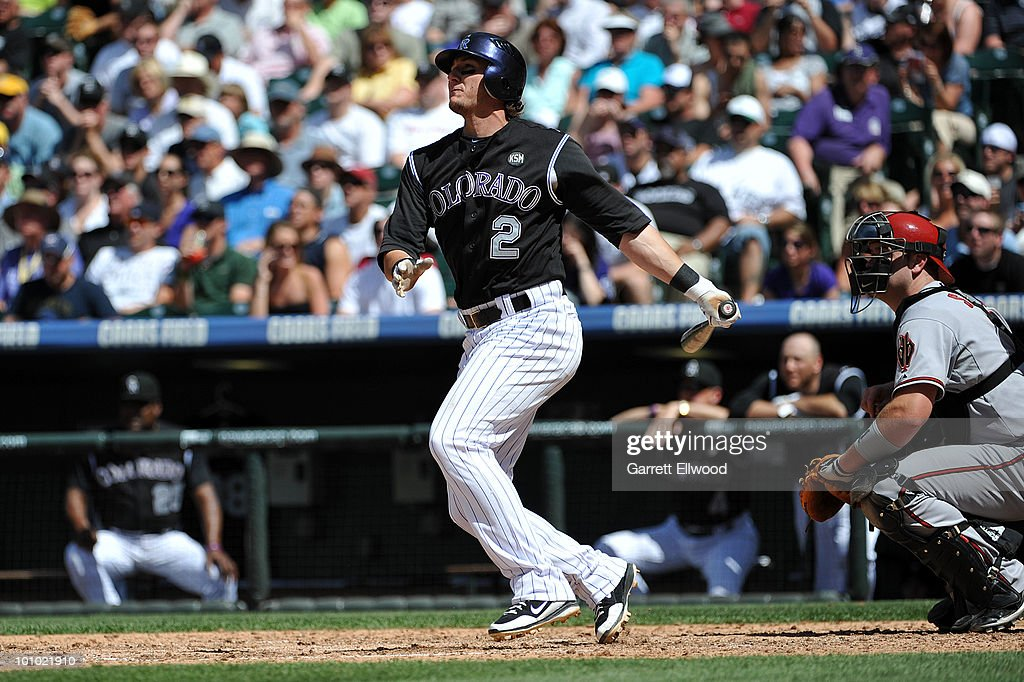 Troy Tulowitzki #2 of the Colorado Rockies watches his hit during the game against the Arizona Diamondbacks at Coors Field on May 27, 2010 in Denver, Colorado.