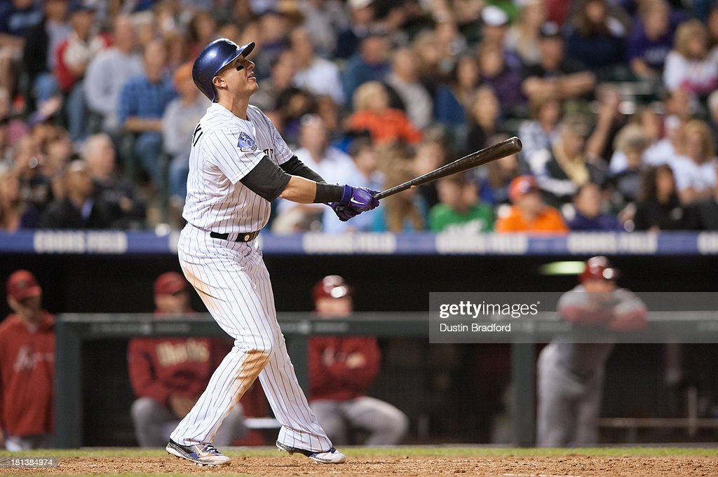 <a gi-track='captionPersonalityLinkClicked' href=/galleries/search?phrase=Troy+Tulowitzki&family=editorial&specificpeople=757353 ng-click='$event.stopPropagation()'>Troy Tulowitzki</a> #2 of the Colorado Rockies watches the flight of a seventh-inning home run against the Arizona Diamondbacks at Coors Field on September 20, 2013 in Denver, Colorado.