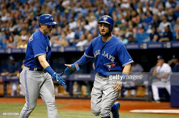 Troy Tulowitzki of the Toronto Blue Jays and Kevin Pillar celebrate near the plate after both scoring off of a triple by Ryan Goins during the sixth...