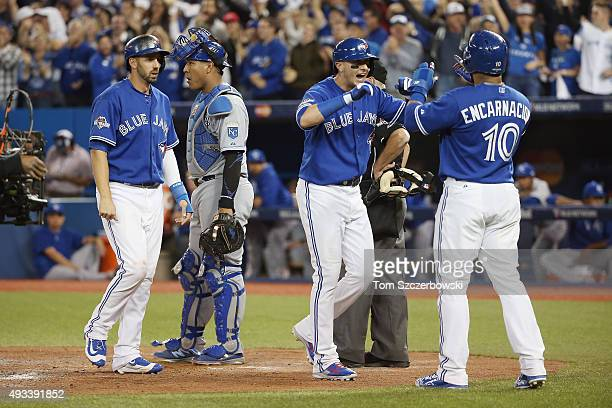 Troy Tulowitzki of the Toronto Blue Jays celebrates after hitting a threerun home run in the third inning against the Kansas City Royals during game...