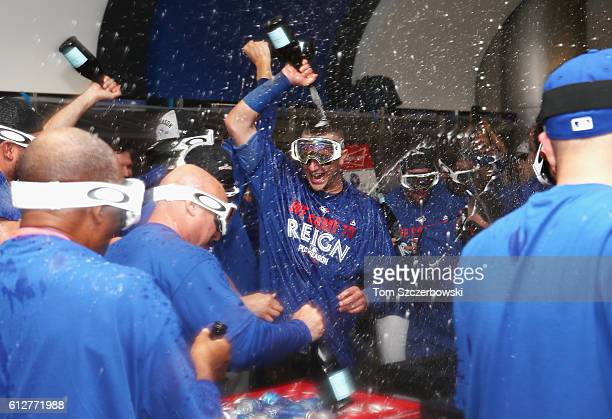 Troy Tulowitzki of the Toronto Blue Jays celebrates in the clubhouse after defeating the Baltimore Orioles 52 in the eleventh inning to win the...