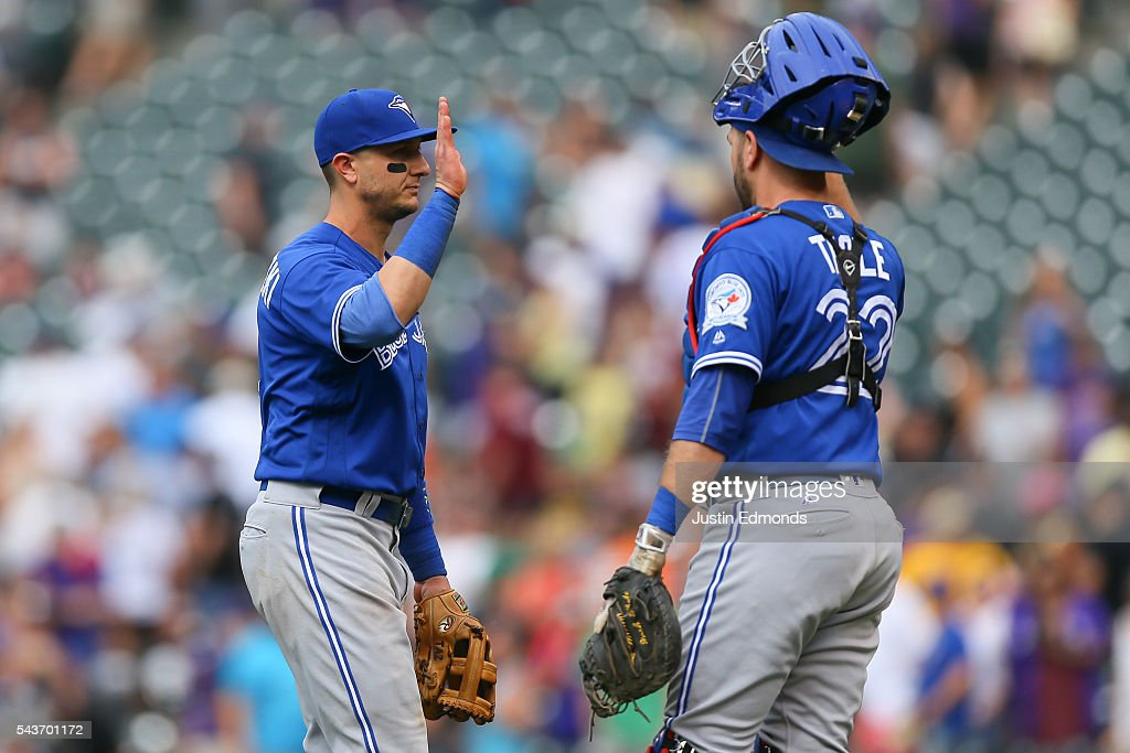 <a gi-track='captionPersonalityLinkClicked' href=/galleries/search?phrase=Troy+Tulowitzki&family=editorial&specificpeople=757353 ng-click='$event.stopPropagation()'>Troy Tulowitzki</a> #2 of the Toronto Blue Jays celebrates the win against the Colorado Rockies with <a gi-track='captionPersonalityLinkClicked' href=/galleries/search?phrase=Josh+Thole&family=editorial&specificpeople=5741573 ng-click='$event.stopPropagation()'>Josh Thole</a> #22 at Coors Field on June 29, 2016 in Denver, Colorado. The Blue Jays defeated the Rockies 5-3.