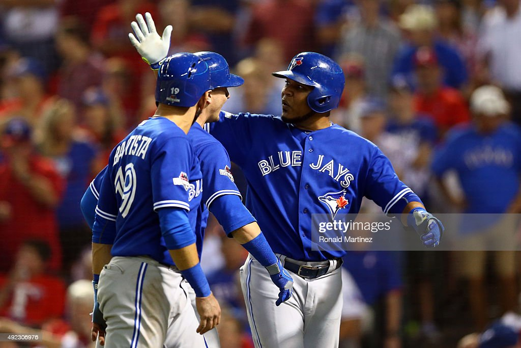 Troy Tulowitzki #2 of the Toronto Blue Jays celebrates with Edwin Encarnacion #10 and Jose Bautista #19 after hitting a three run home run against Chi Chi Gonzalez #21 of the Texas Rangers in the sixth inning during game three of the American League Division Series on October 11, 2015 in Arlington, Texas.