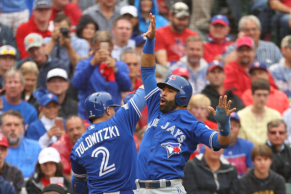 Troy Tulowitzki of the Toronto Blue Jays celebrates with Jose Bautista after Tulowitzki hit a home run against the Texas Rangers in the second inning...