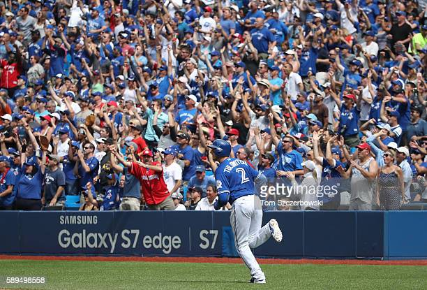 Troy Tulowitzki of the Toronto Blue Jays circles the bases as he hits a threerun home run in the fifth inning during MLB game action against the...
