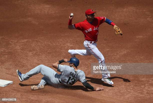 Troy Tulowitzki of the Toronto Blue Jays gets the force out of Joey Gallo of the Texas Rangers at second base but cannot turn the double play in the...