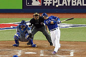 Troy Tulowitzki of the Toronto Blue Jays hits a threerun RBI double in the sixth inning against the Kansas City Royals during game five of the...
