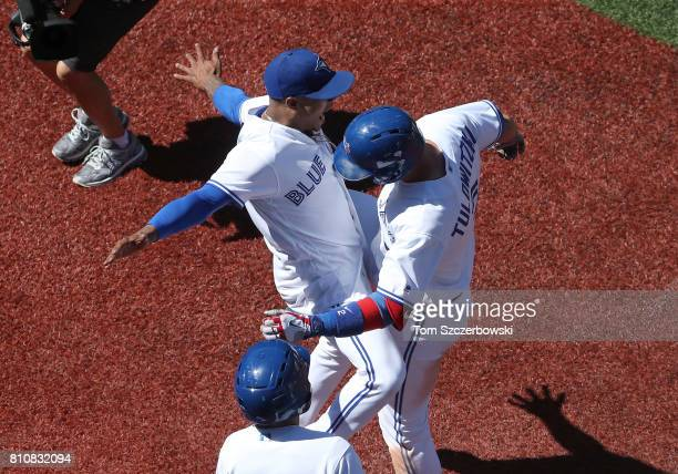 Troy Tulowitzki of the Toronto Blue Jays is congratulated by Marcus Stroman after hitting a threerun home run in the seventh inning during MLB game...
