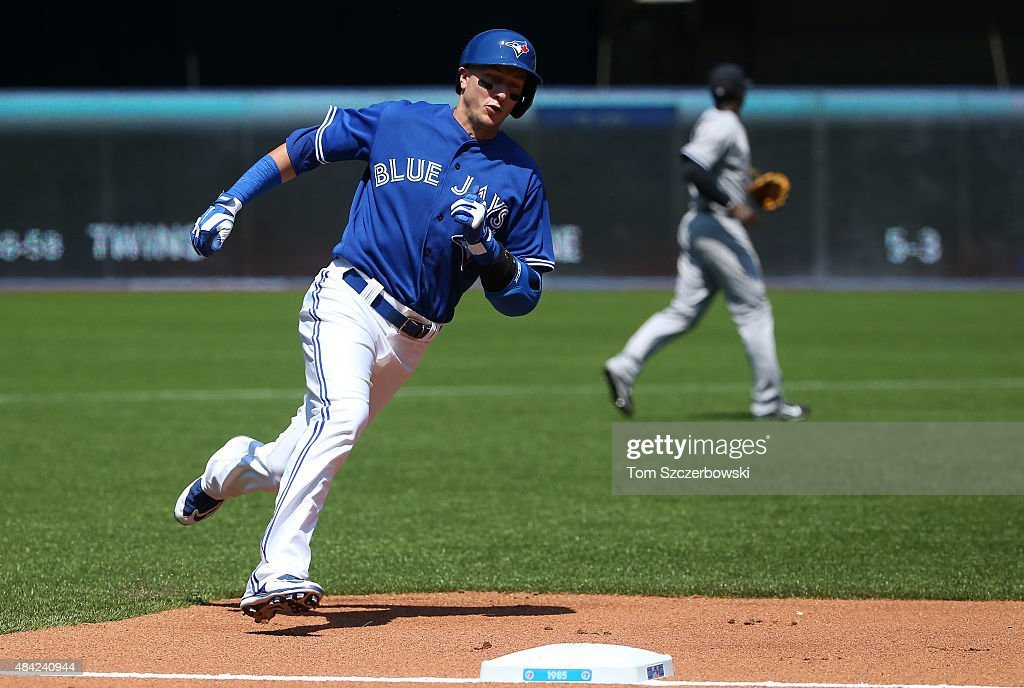 Troy Tulowitzki #2 of the Toronto Blue Jays races home around third base to score a run on an RBI single by Josh Donaldson #20 in the third inning during MLB game action against the New York Yankees on August 16, 2015 at Rogers Centre in Toronto, Ontario, Canada.