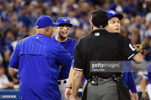 Troy Tulowitzki of the Toronto Blue Jays reacts as he is ejected from the game in the eighth inning against the Kansas City Royals during game three...