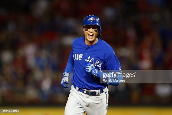 Troy Tulowitzki of the Toronto Blue Jays rounds the bases after hitting a three run home run against Chi Chi Gonzalez of the Texas Rangers in the...