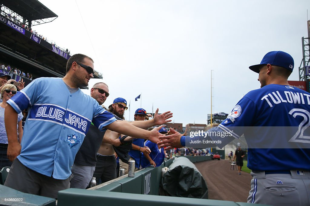 <a gi-track='captionPersonalityLinkClicked' href=/galleries/search?phrase=Troy+Tulowitzki&family=editorial&specificpeople=757353 ng-click='$event.stopPropagation()'>Troy Tulowitzki</a> #2 of the Toronto Blue Jays shakes hands with fans after the game against the Colorado Rockies at Coors Field on June 29, 2016 in Denver, Colorado. The Blue Jays defeated the Rockies 5-3.