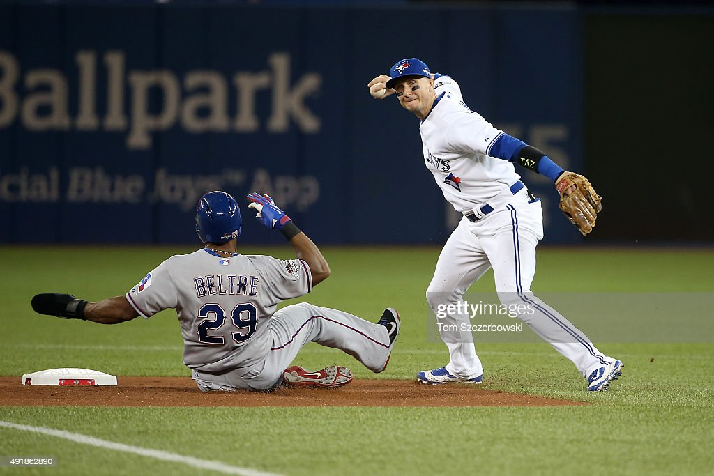 Troy Tulowitzki of the Toronto Blue Jays tags out Adrian Beltre of the Texas Rangers hit by Prince Fielder of the Texas Rangers in the first inning...