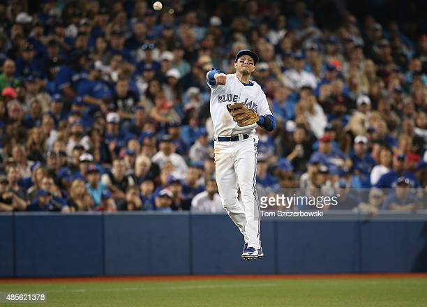 Troy Tulowitzki of the Toronto Blue Jays throws out the baserunner in the eighth inning during MLB game action against the Detroit Tigers on August...