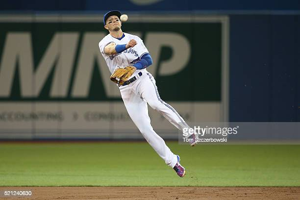 Troy Tulowitzki of the Toronto Blue Jays throws out the baserunner in the third inning during MLB game action against the New York Yankees on April...