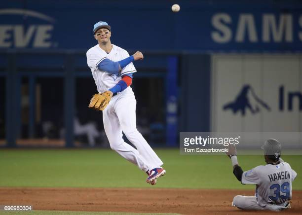 Troy Tulowitzki of the Toronto Blue Jays turns a double play to end the fifth inning during MLB game action as Alen Hanson of the Chicago White Sox...