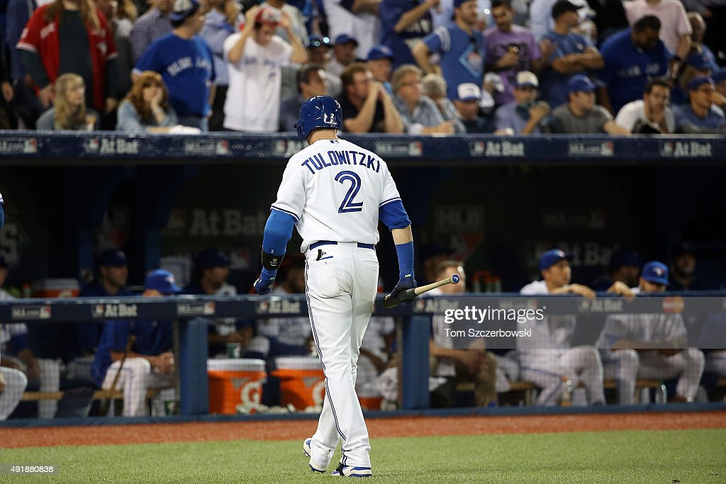 Troy Tulowitzki #2 of the Toronto Blue Jays walks back to the dugout after being struck by Sam Dyson #47 of the Texas Rangers in the ninth inning during game one of the American League Division Series at Rogers Centre on October 8, 2015 in Toronto, Ontario, Canada.