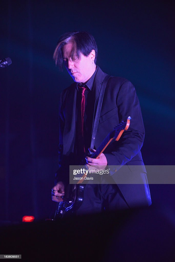 Troy Van Leeuwen of Queens of the Stone Age performs at Nashville Municipal Auditorium on October 7, 2013 in Nashville, Tennessee.