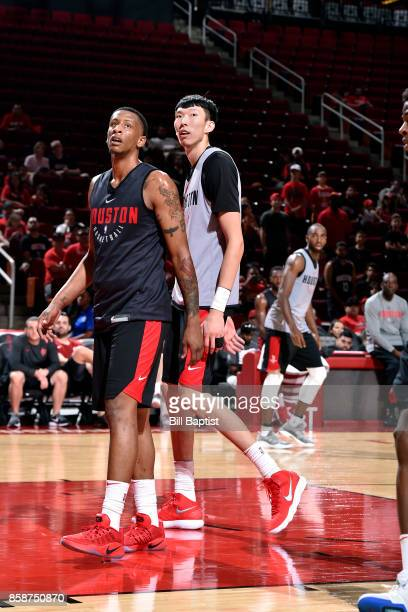 Troy Williams and Zhou Qi of the Houston Rockets participate in the team's annual Fan Fest event on October 7 2017 at the Toyota Center in Houston...