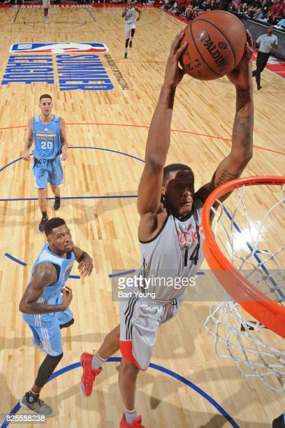 Troy Williams of the Houston Rockets dunks the ball during the 2017 Summer League game against the Denver Nuggets on July 12 2017 at the Thomas Mack...