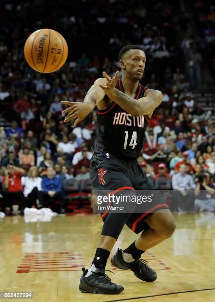 Troy Williams of the Houston Rockets passes the ball in the first half against the Detroit Pistons at Toyota Center on April 7 2017 in Houston Texas...