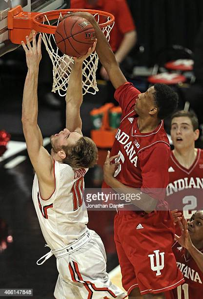 Troy Williams of the Indiana Hoosiers blocks a shot by Jake Layman of the Maryland Terrapins during the quarterfinal round of the 2015 Big Ten Men's...