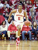 Troy Williams of the Indiana Hoosiers dribbles the ball during the game against the Minnesota Golden Golphers at Assembly Hall on February 15 2015 in...