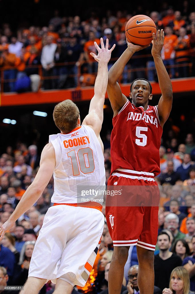 Troy Williams #5 of the Indiana Hoosiers takes a shot over Trevor Cooney #10 of the Syracuse Orange during the second half at the Carrier Dome on December 3, 2013 in Syracuse, New York. Syracuse defeated Indiana 69-52.