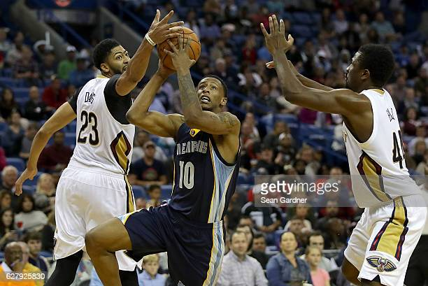 Troy Williams of the Memphis Grizzlies is blocked by Anthony Davis of the New Orleans Pelicans during the second half at the Smoothie King Center on...
