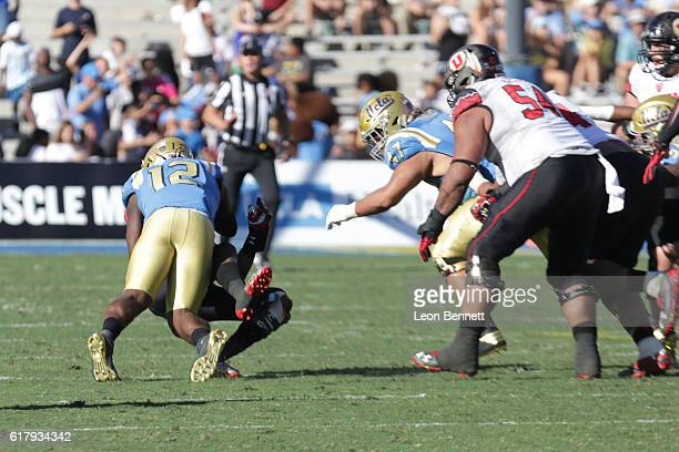 Troy Williams of the UTAH Utes gets sacked by Jayon Brown of the UCLA Brunns during a college football game the at Rose Bowl on October 22 2016 in...
