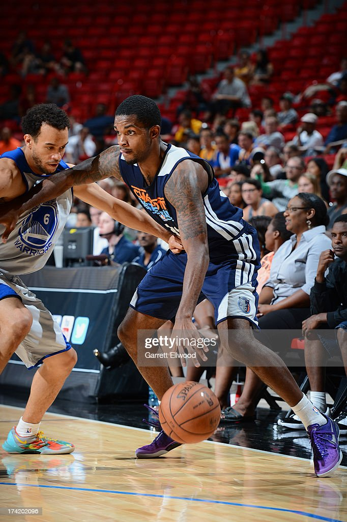Troy Daniels #30 of the Charlotte Bobcats drives against Cameron Jones #6 of the Golden State Warriors during NBA Summer League game between the Charlotte Bobcats and the Golden State Warriors on July 21, 2013 at the Cox Pavilion in Las Vegas, Nevada.