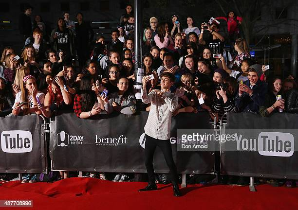 Troye Sivan takes a selfie in font of fans at Qantas Credit Union Arena on September 11 2015 in Sydney Australia