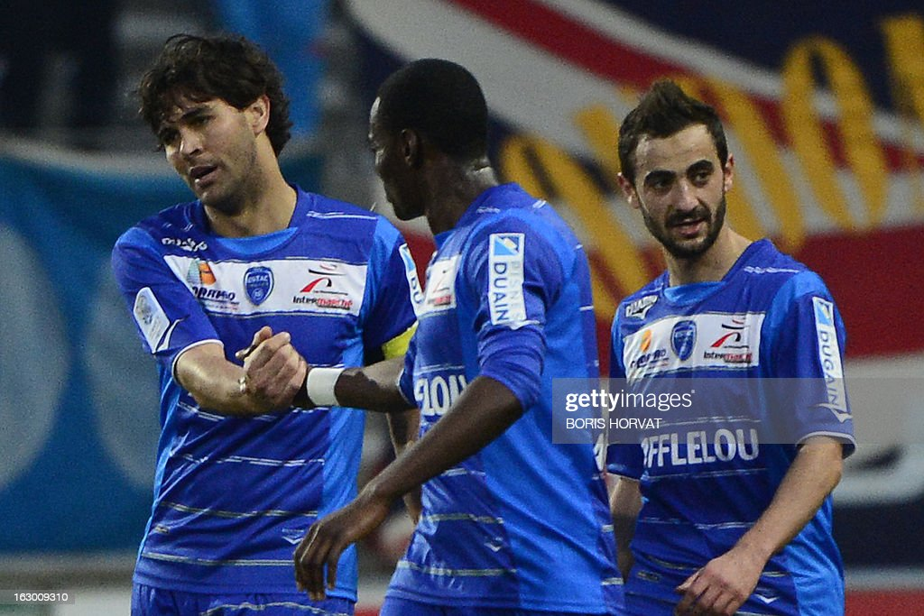 Troyes' Brasilian forward Marcos (L) celebrates with teammates after scoring during the French L1 football match Olympique of Marseille (OM) vs Troyes (ESTAC) at the Velodrome stadium in Marseille, on March 3, 2013.