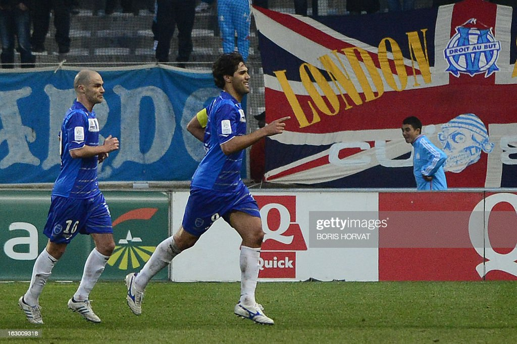 Troyes' Brazilian forward Marcos (R) celebrates with a teammate after scoring during the French L1 football match Olympique of Marseille (OM) vs Troyes (ESTAC) at the Velodrome stadium in Marseille, on March 3, 2013.