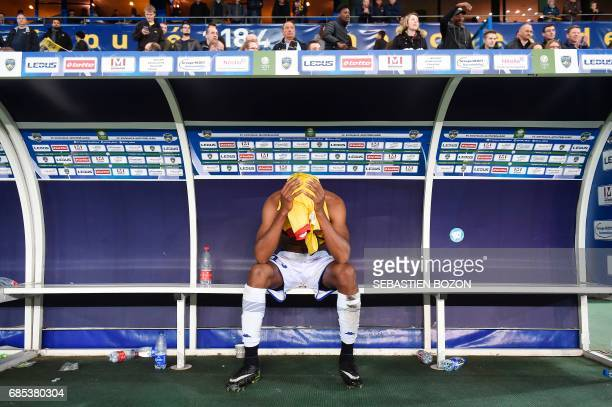 TOPSHOT Troyes' Cameroonese forward Henri Ntsama reacts after the French L2 football match Sochaux versus Troyes on May 19 2017 at the Auguste Bonal...
