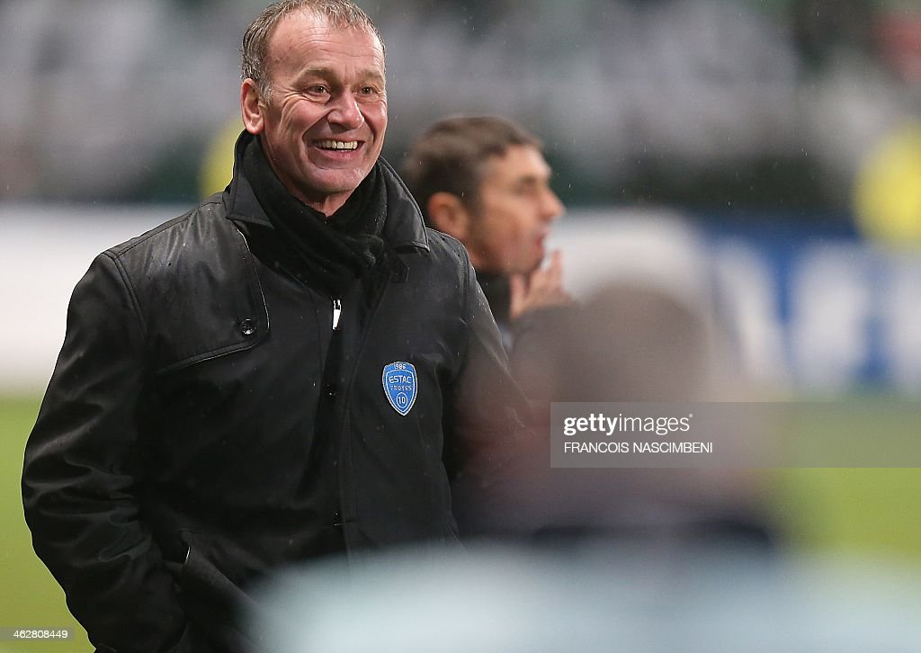 Troyes' coach Jean-Marc Furlan celebrates after Troyes won the French League Cup quarter final football match Troyes vs Evian, on January 15, 2014 at the Aube Stadium in Troyes.