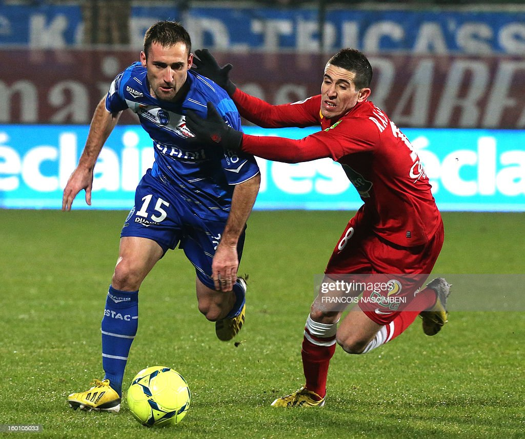 Troyes' defender Florian jarjat (L) vies with Brest's defender Florian Raspentino (R) during the French L1 football match Troyes vs Brest on January 26, 2013 at the Aube stadium in Troyes. PHOTO