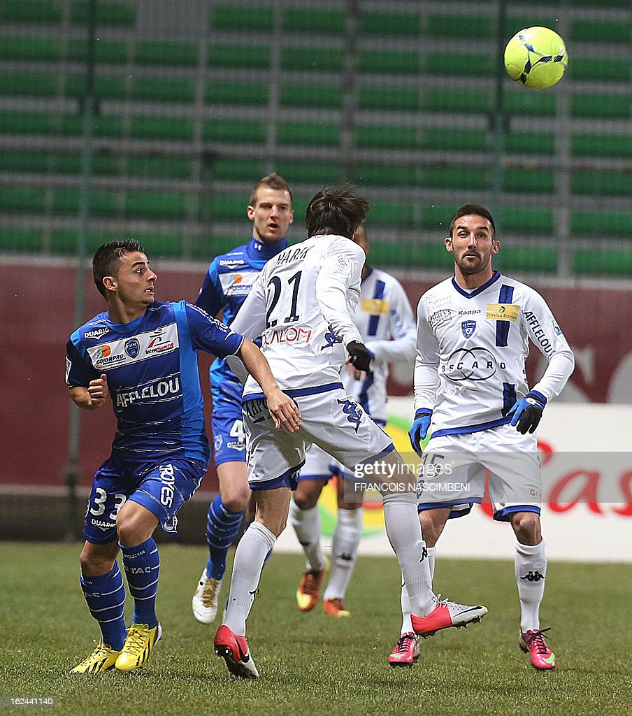 Troyes' defender Jean Corentin (L) vies with Bastia's Algerian defender Fethi Harek (C), on February 23, 2013 during the French L1 football match Troyes vs Bastia in the Aube Stadium in Troyes. PHOTO
