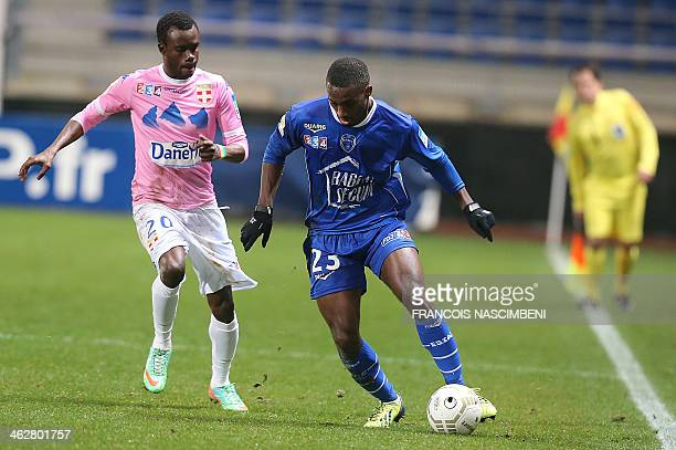 Troyes' defender Lionel Carole vies with Evian's forward Modou Sougou during the French League Cup quarter final football match Troyes vs Evian on...
