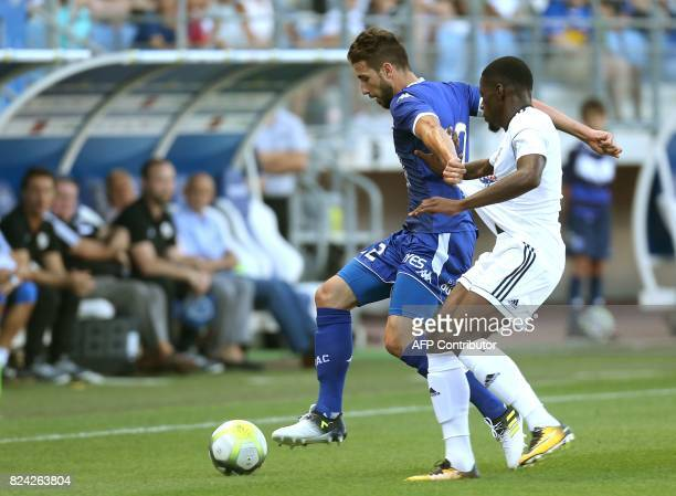 Troyes' defender Mathieu Deplagne vies for the ball against Amiens' forward Harrisson Manzala during the friendly football match between Troyes and...