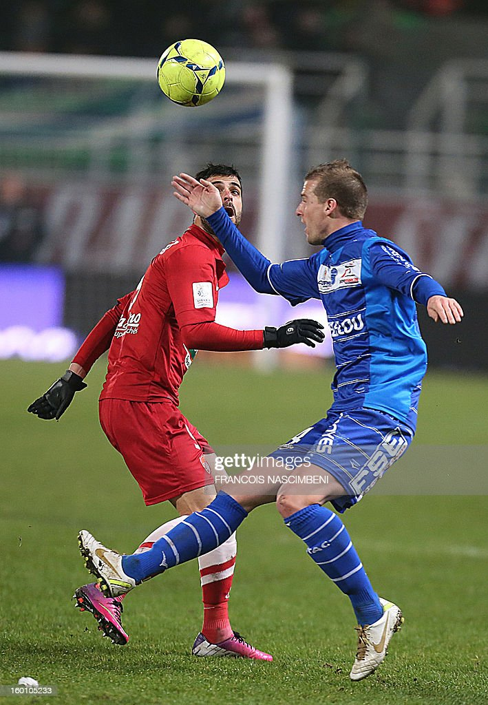 Troyes' defender Stephane Darbion (R) vies with Brest's Israelian forward Eden Ben Basat (L) during the French L1 football match Troyes vs Brest on January 26, 2013 at the Aube stadium in Troyes. PHOTO FRANCOIS NASCIMBENI