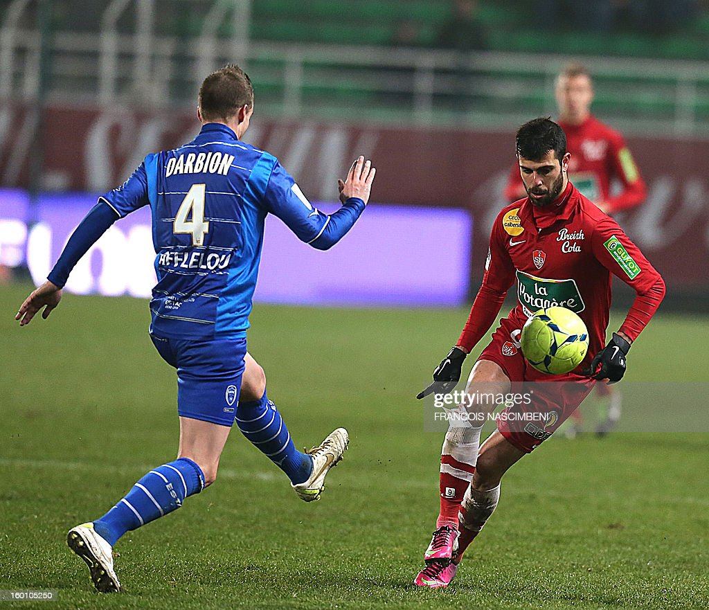 Troyes' defender Stephane Darbion (L) vies with Brest's Israelian forward Eden Ben Basat (R) during the French L1 football match Troyes vs Brest on January 26, 2013 at the Aube stadium in Troyes. PHOTO FRANCOIS NASCIMBENI