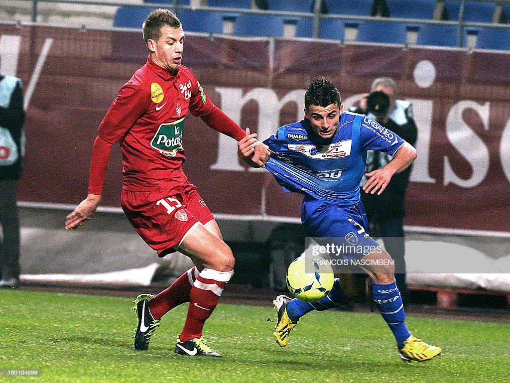 Troyes' forward Jean corentin (R) vies with Brest's defender Florian Lejeune (L) during the French L1 football match Troyes vs Brest on January 26, 2013 at the Aube stadium in Troyes. PHOTO